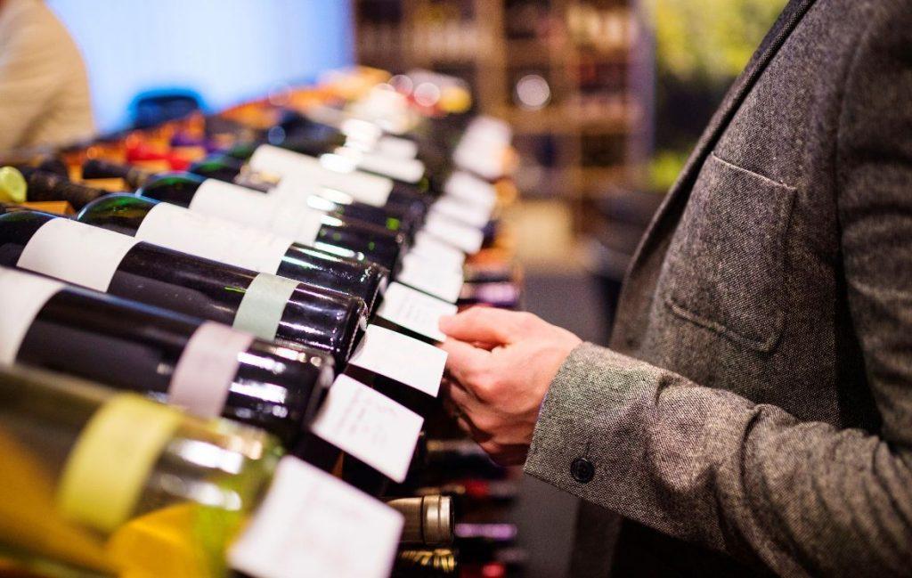 young man choosing wine